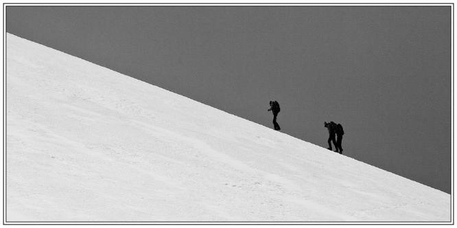 Up the snow slope towards the summit - Steve Robinson